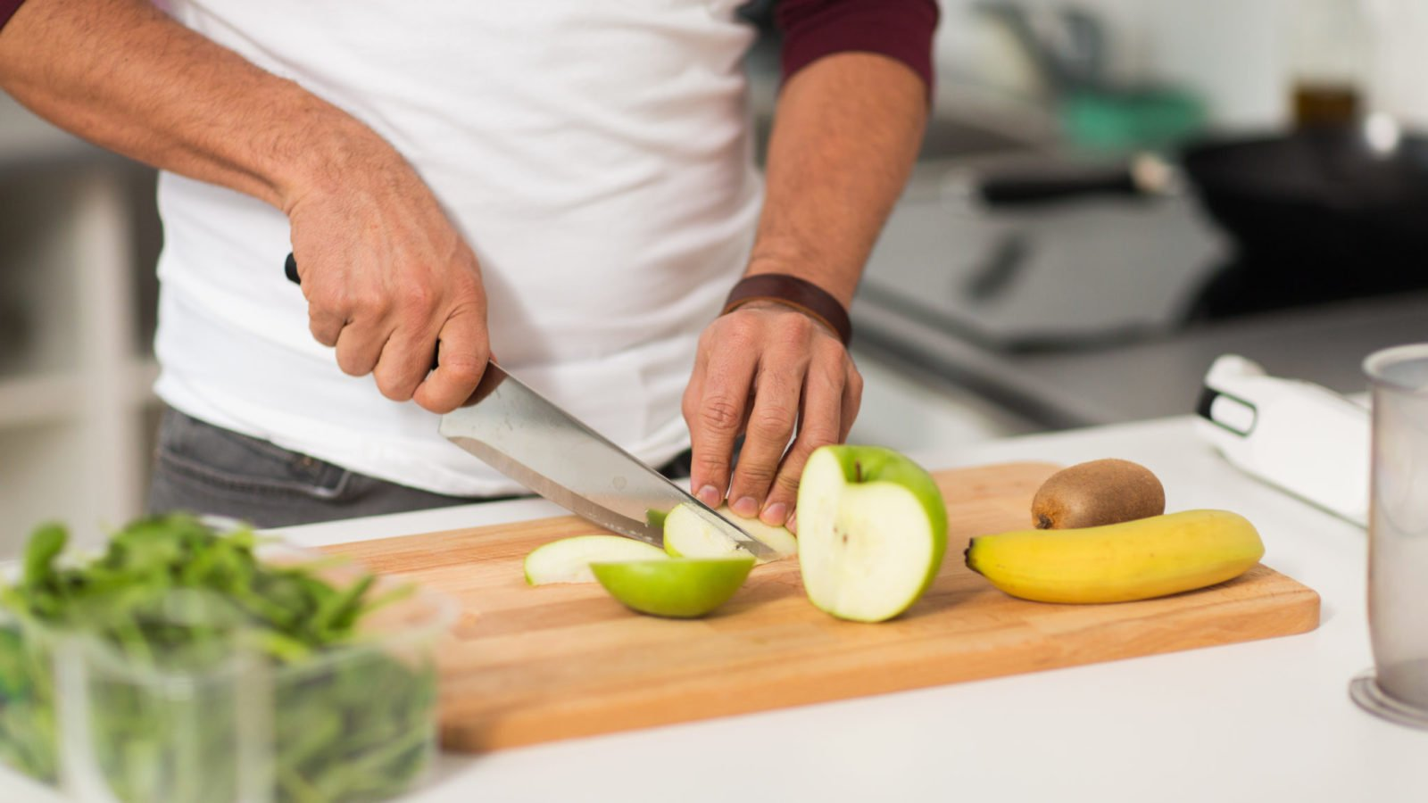 photo of man preparing healthy food, important in nutritional epigenetics