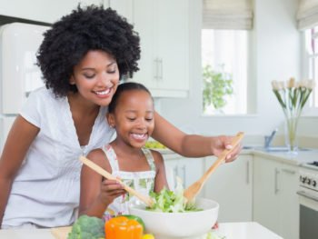 photo of mother and daughter preparing healthy food