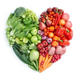 photo of red, green, and orange fruits and vegetables in the shape of a heart